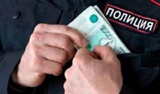 Начальник отдела уголовного розыска обвиняется в получении взятки